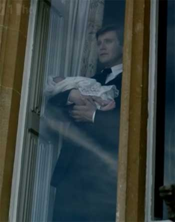 Branson holds his baby