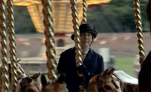Mrs Hughes disapproves while riding the merry go round